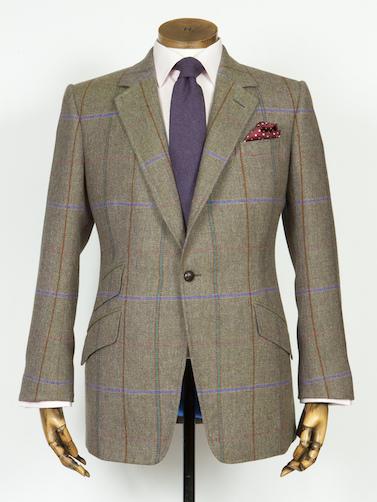 Косые карманы на жокейском пиджаке Huntsman