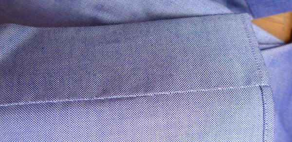планка сорочки пришита вручную